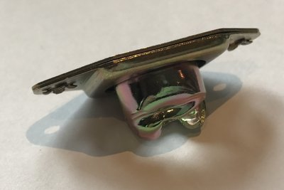 Cam lock retainer plate